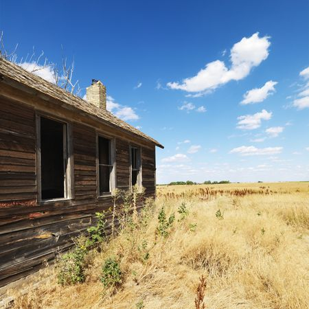 Side of wooden dilapidated building in rural field. Stock Photo - 2537848