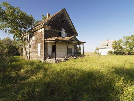 farm house: Abandoned farm house in rural field.