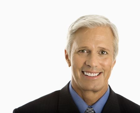 Middle aged Caucasian man in business suit smiling at viewer. Stock Photo - 2555031