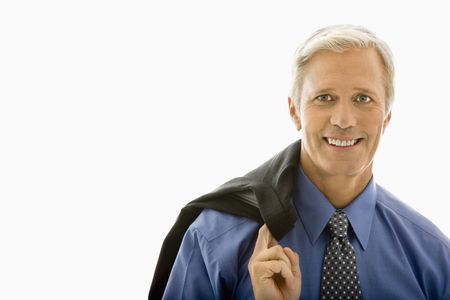 Middle aged Caucasian man in business suit smiling at viewer with jacket draped over shoulder. photo