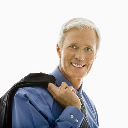 Middle aged Caucasian man in business suit smiling at viewer with jacket draped over shoulder. Stock Photo - 2555084