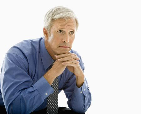 worry: Middle aged Caucasian man with thoughtful expression. Stock Photo