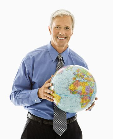 Middle aged Caucasian man holding globe and smiling at viewer. photo