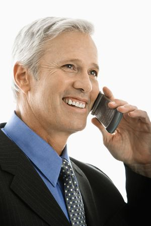 Caucasian middle aged man smiling and talking on cell phone. photo