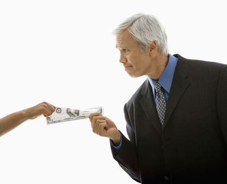 corporate greed: Caucasian middle aged businessman pulling one hundred dollar bill from woman. Stock Photo
