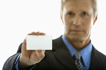 Caucasian middle aged man holding business card and looking at viewer. photo
