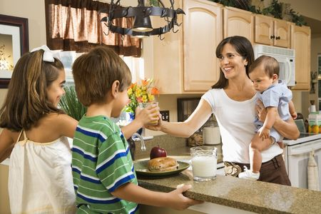Hispanic family in kitchen with breakfast.  photo