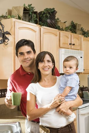 Hispanic family portrait in home kitchen with baby. Stock Photo - 2555872