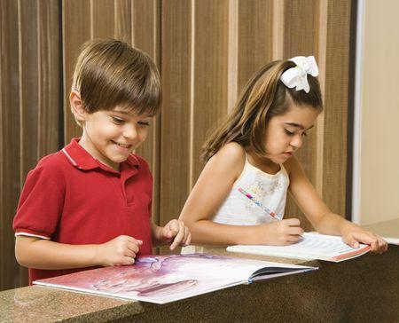 Hispanic brother and sister doing homework. Stock Photo - 2555908