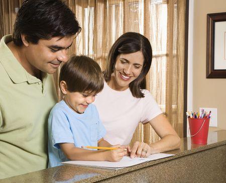 Hispanic parents helping son with homework. Stock Photo - 2555983