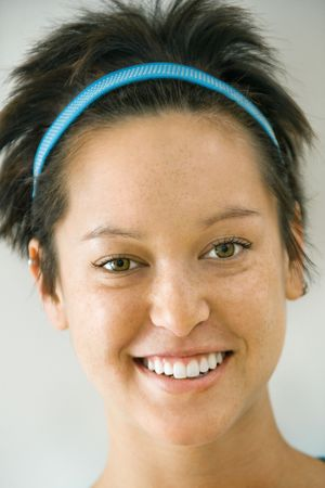 Headshot of smiling young Caucasian woman with short brown hair. Stock Photo - 2555759