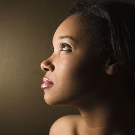 woman profile: Profile of serious African-American young adult female. Stock Photo