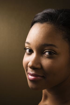 Smiling African-American young adult female looking at viewer photo