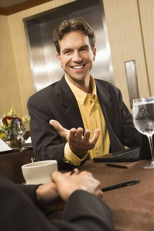 Caucasian businessman gesturing during meeting. Stock Photo - 2615952