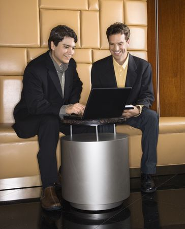 Businessmen  talking and viewing laptop computer. Stock Photo - 2615919