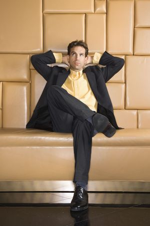 Caucasian businessman with hands behind head rolling eyes. Stock Photo - 2615834