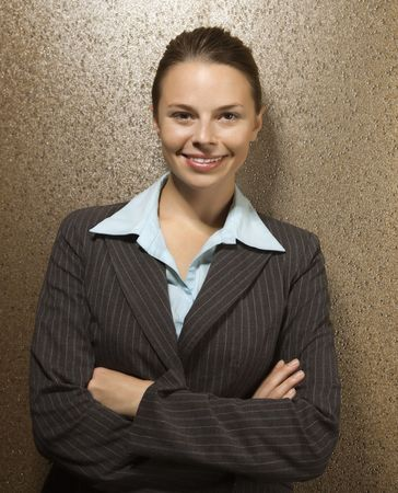 Attractive Caucasian businesswoman smiling at viewer with arms crossed. Stock Photo - 2616139
