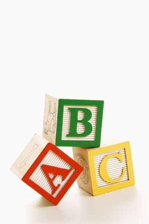 letter blocks: ABC alphabet blocks stacked together.