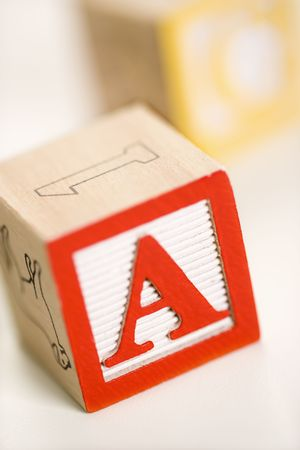 Selective focus of alphabet blocks with letter A in foreground. Stock Photo - 2622978