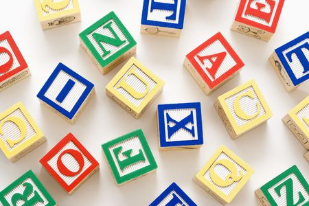 letter blocks: Alphabet building block scattered on white background. Stock Photo