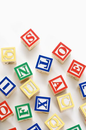Alphabet building block scattered on white background. Stock Photo - 2616863