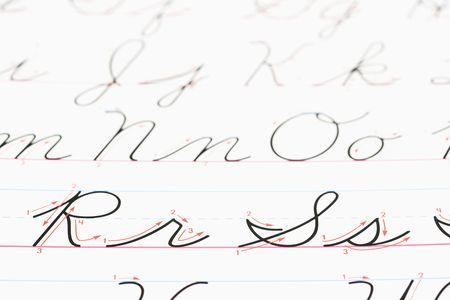 cursive: Close up of cursive handwriting practice page. Stock Photo