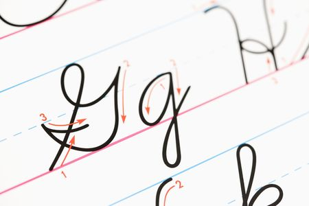 penmanship: Close up of cursive handwriting practice page. Stock Photo