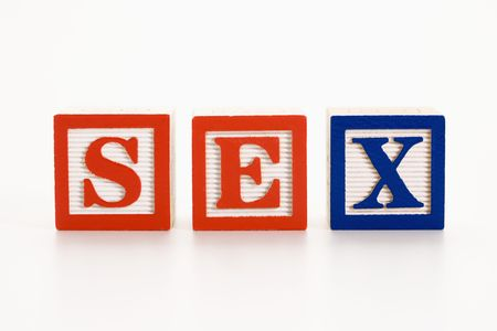 sex education: Alphabet toy building blocks spelling the word sex.