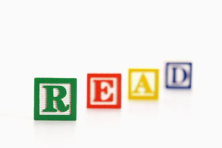 lined up: Alphabet toy building blocks spelling the word read. Stock Photo