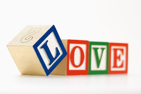 Alphabet toy building blocks spelling the word love. photo