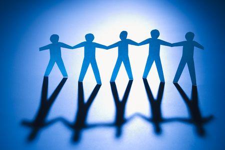 Cutout paper men standing holding hands. Stock Photo - 2616864