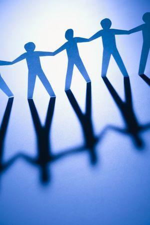 Cutout paper men standing holding hands. Stock Photo - 2616855