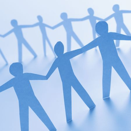 Cutout paper men standing holding hands. photo