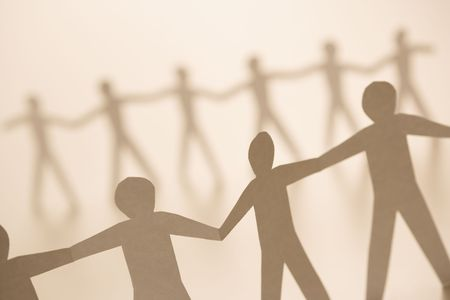 Cutout paper men standing holding hands. Stock Photo - 2616695