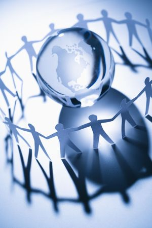 Cutout paper people standing around globe holding hands. Stock Photo - 2616833
