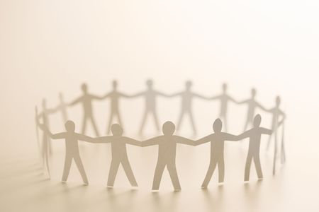 Cutout paper people standing in circle holding hands. Stock Photo - 2616687