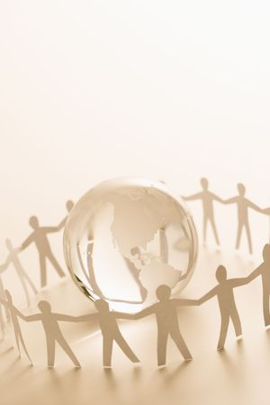 Cutout paper people standing around globe holding hands. Stock Photo - 2616702