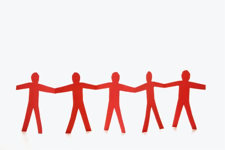 Red cutout paper men standing holding hands. Stock Photo - 2616704