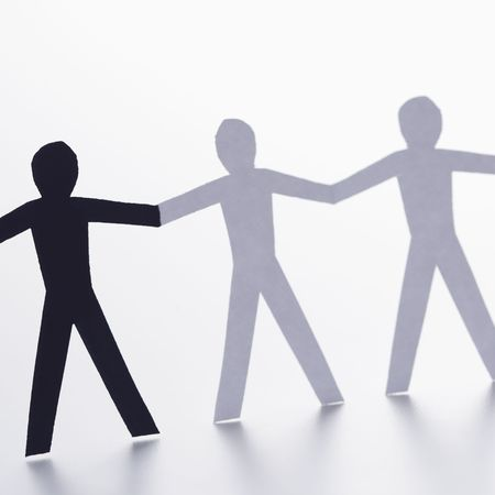Black and white cutout paper people holding hands. Stock Photo - 2622954