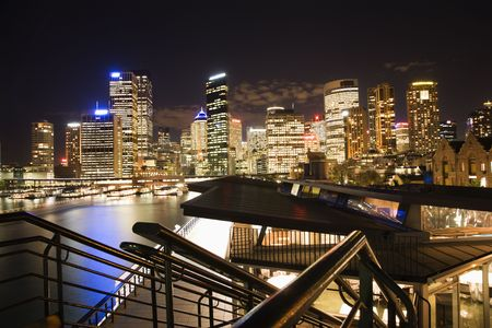port jackson: Night cityscape with buildings and harbor in Sydney, Australia. Stock Photo