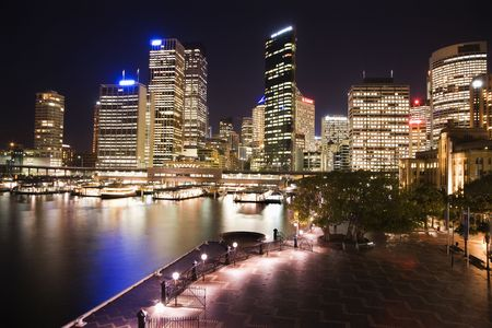 Cityscape of Sydney, Australia with harbor and buildings at night. photo