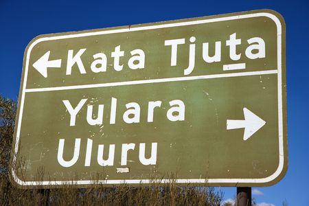 kata: Road sign with direction to Kata Tjuta and Yulara Uluru in Uluru Kata Tjuta National Park, Australia. Stock Photo