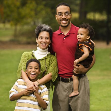 Portrait of happy smiling family of four in park. Stock Photo - 2615867