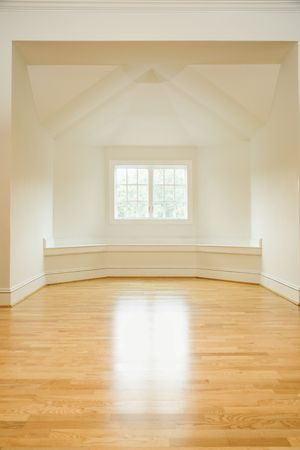 moulding: Empty room in house with sunlight coming through window on hardwood floors. Stock Photo