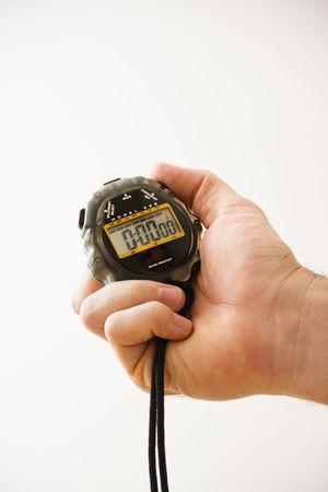 Detalle de adulto de sexo masculino lado la celebración de cronómetro.