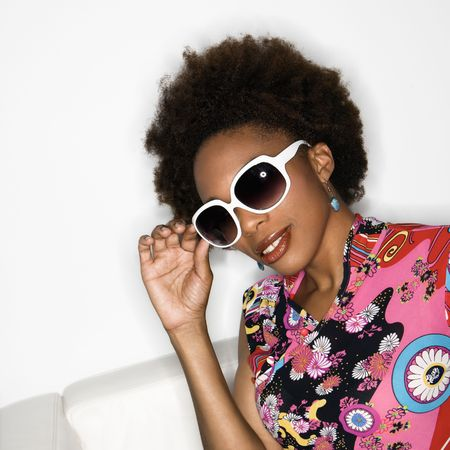 Woman with afro wearing vintage print fabric and oversized sunglasses. photo