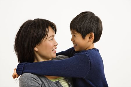 Asian mother and son hugging and smiling. Stock Photo - 2615951