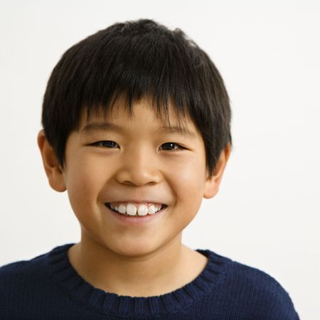 Portrait of young Asian boy smiling. photo