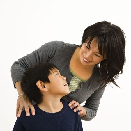 Asian mother smiling at young son. Stock Photo - 2622864