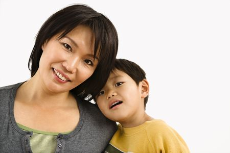 eachother: Portrait of Asian mother and young son leaning on eachother.